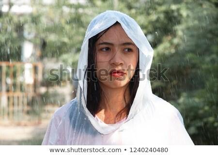 portrait of a cheerful teenage girl wearing raincoat stock photo © deandrobot