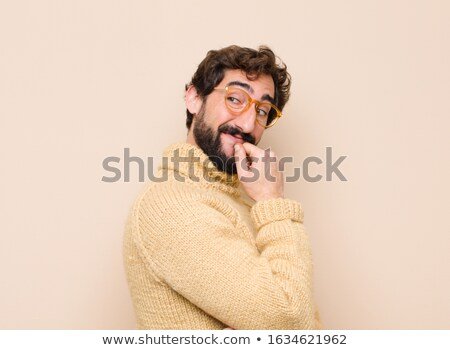 Thoughtful handsome man with hand on chin Stock photo © wavebreak_media