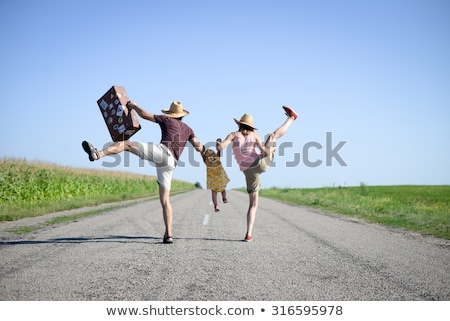 Family jumping in country field Stock photo © IS2