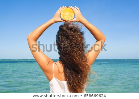 girl holding pineapple slices stock photo © is2