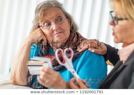 Pénzügyi tanácsadó olló idős hölgy tart Stock fotó © feverpitch