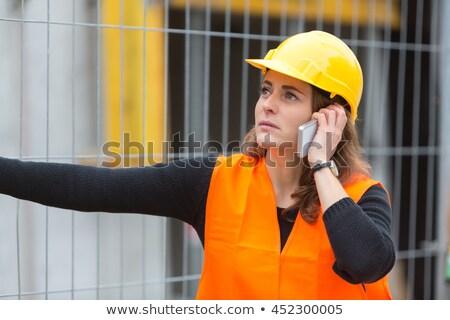 Női mérnök beszél mobiltelefon építkezés emberek dolgoznak Stock fotó © diego_cervo