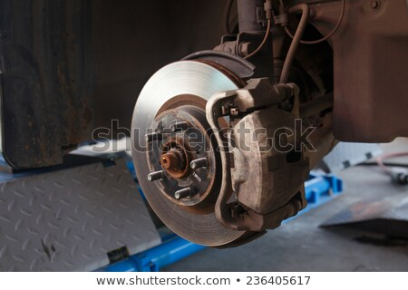 Stock photo: Detail image of car's break assembly after repair.