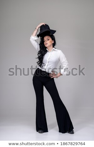 Studio portrait of stylish pretty fun brunette girl in trendy clothes showing stick out and having f Stock photo © studiolucky