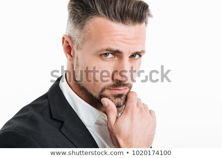 Image of handsome businessman 30s in black jacket looking at cam Stock photo © deandrobot