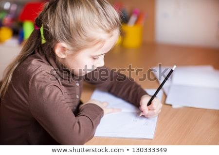 Cute Little Girl Left Handed Writing Her Homework Foto d'archivio © Len44ik