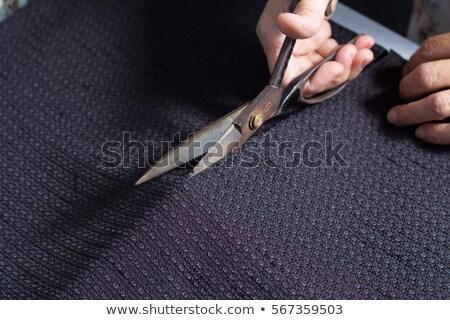 Tailor cutting fabric with scissors Foto stock © Kzenon