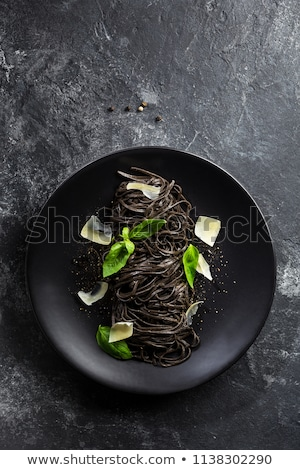 Black pasta with mussels and parmesan stock photo © Alex9500