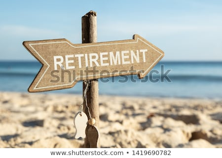 Retirement Directional Sign On Beach Stock photo © AndreyPopov