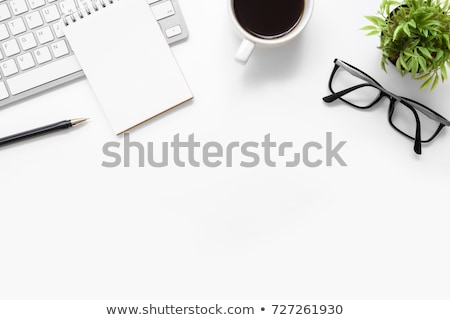 Office table with blank page, supplies and computer stock photo © karandaev