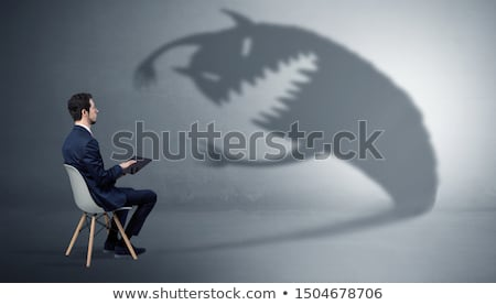 Businessman negotiate with a monster shadow Stock photo © ra2studio