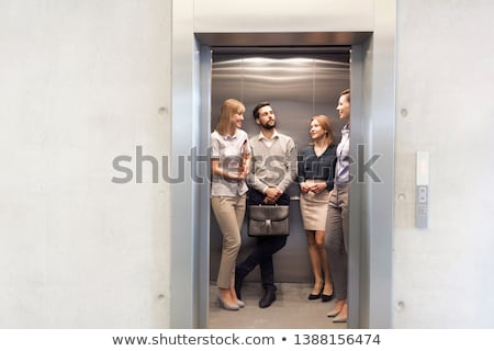ビジネスマン 女性実業家 話し エレベーター 側面図 立って ストックフォト © AndreyPopov