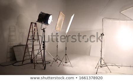 Video production gear on a set - big light stand and tripod Stock photo © galitskaya