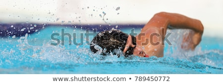 Male swimmer swimming crawl in an outdoor pool Stock photo © lightpoet