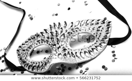 Bright silver masquerade mask on white Stock photo © evgeny89