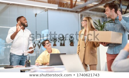 Young handsome businessman moving to new workplace  Stock photo © Elnur