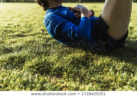 Fit man training abs muscles situp crunches bodyweight floor exercises at home or fitness gym. Fitne Stock photo © Maridav