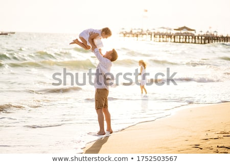 Parents with daughter in sea Stock photo © Paha_L