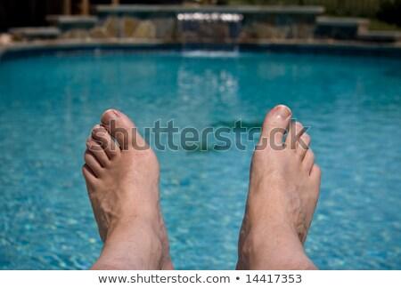 voeten · heldere · Blauw · zwembad · zwemmen · dag - stockfoto © backyardproductions