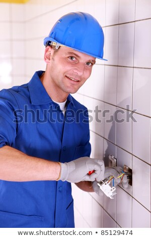Electricians wiring a large white tiled room Stock photo © photography33