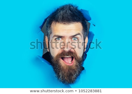 Man's head peering out of paper hole Stock photo © photography33