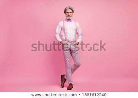 Jólöltözött mosolyog idős férfi pózol kéz Stock fotó © stockyimages