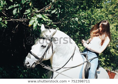 Teen with white horse Stock photo © photography33