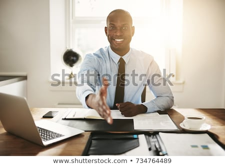 Stock photo: business man welcoming at his desk