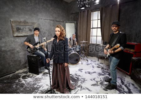 Young rock band with female vocalist Stock photo © photography33