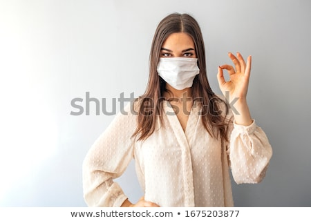Young woman in a surgical mask Stock photo © photography33