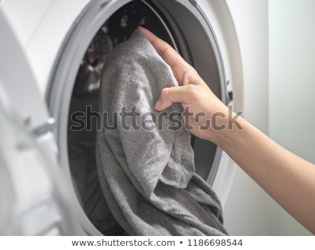 Close-up of a young woman doing laundry  Stock photo © wavebreak_media