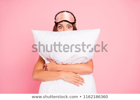 Kobieta poduszkę szykowny młoda kobieta bed patrząc Zdjęcia stock © pressmaster