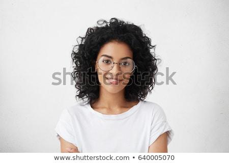 Joyful female posing while standing against a white background stock photo © wavebreak_media