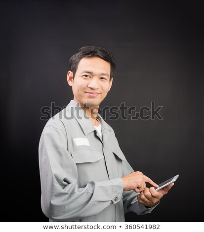 Happy man holding clip-board and pen stock photo © photography33