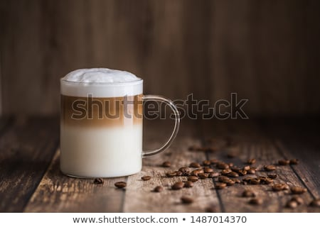 coffee cup with coffee beans next to it stock photo © justinb