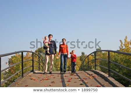family of four on autumn bridge stock photo © Paha_L