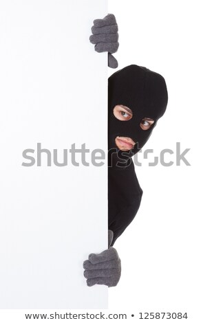 Thief looking around a blank sign Stock photo © AndreyPopov