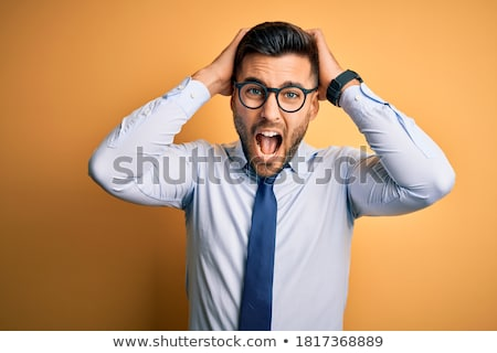 Businessman with a scared fearful expression Stock photo © smithore