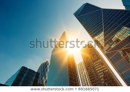 reflection of the sun in the facade of a skyscraper stock photo © meinzahn