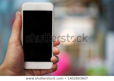 Hand holding smartphone in city cafe stock photo © pab_map