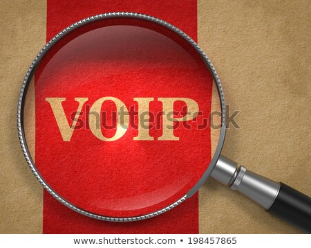 voip magnifying glass on old paper stock photo © tashatuvango