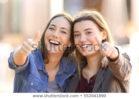 Beautiful young woman showing smiley face Stock photo © bmonteny