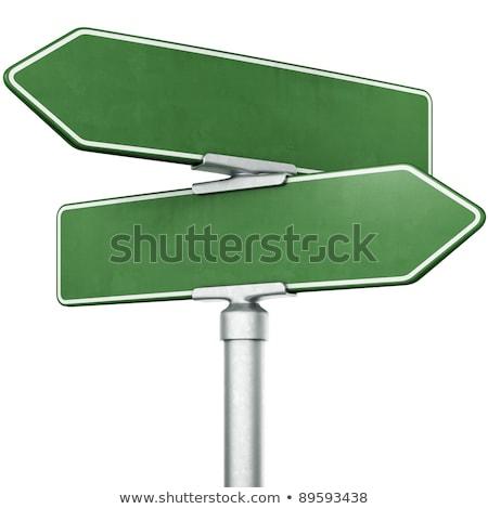 Jelzőtáblák mutat ellenkező irányok kettő kék ég Stock fotó © szefei