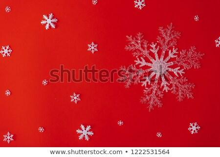 Surreale fiocchi di neve design rosso abstract onde Foto d'archivio © oblachko