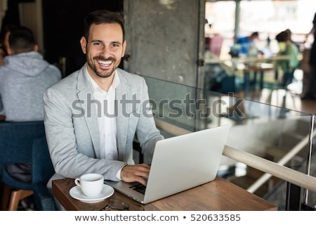 elegant business man sitting on a sidewalk  Stock photo © feedough