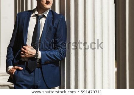Jólöltözött férfi kék kezek üzletember öltöny Stock fotó © gemenacom