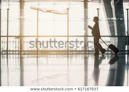 Silhouette of a woman walking on a board Stock photo © gemenacom
