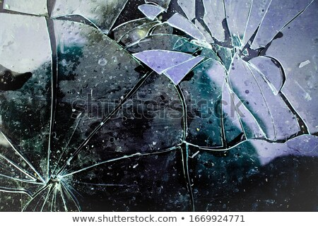 Glass break and shatter with motion blur on black Stock photo © Arsgera