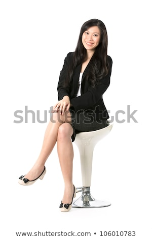 young elegant woman sitting on a stool Stock photo © feedough