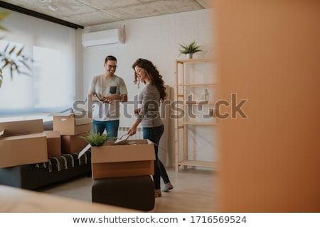 Woman unpacking while moving house Stock photo © ivonnewierink
